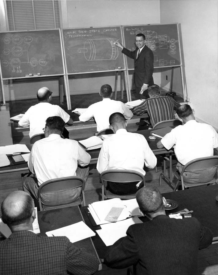 8x10 Black & White photograph  CF&I Auditing Dept.  New Computer Classes  Eight men are pictured attending a computer class. 1962 June 04  Negative No. 8048